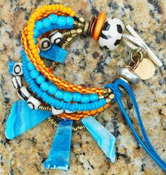 Bermuda Bracelet: OMG Amazing! Color your world with this spectacular tribal, island-inspired summer statement bracelet! A gorgeous palette of oranges and blues