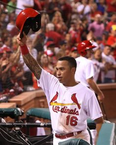 St. Louis Cardinals' Kolten Wong emerges from the dugout for a curtain call after hitting his second home run of the game in seventh inning ...8.7.14