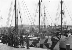 The port of Fècamp, Normandy, France, fall Practicing for Operation Sealion - a group of mountain troops (Gebirgsjäger) waiting to embark. Alfred Jodl, Luftwaffe, Churchill, Operation Sea Lion, German Army, War Machine, World War Two, Ww2, Normandy France