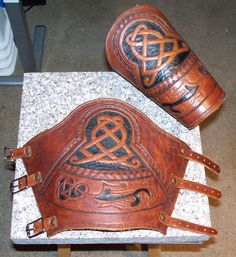 Targe Bracers by sgtevmckay Leather Quiver, Leather Bracers, Leather Cuffs, Leather Tooling, Leather Gauntlet, Leather Working Patterns, Larp Armor, Leather Carving, Armor Concept