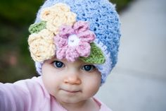 Crocheted baby hat with flowers