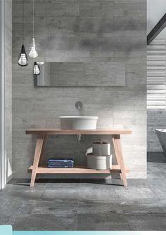 Une salle de bain claire et épurée. Aspect béton pour un style moderne. Par Samse sur http://www.lecoupdepouceauxparticuliers.com/