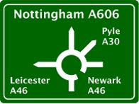 Large roundabout sign, a lot of info,using number letters and symbols conveys it well. Mary Calvert designed the typeface specifically in lower case so that from a distance place names take on an individual shape easily recognizable from far away