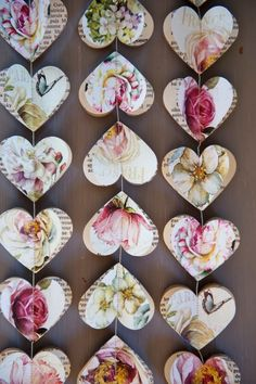Strung paper hearts - cut out of books - vintage paper or cards