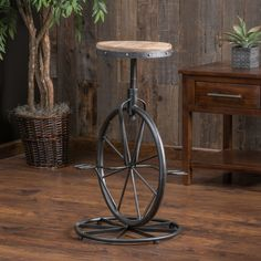 Cute--- I'm thinking for the fairy garden though... Charles Bicycle Wheel Adjustable Bar Stool