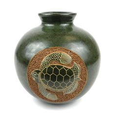 This decorative vase from Nicaragua is 6 inches tall and 5.5 inches in diameter, featuring a lovely emerald turtle design. This is low fired and not designed to hold water. Meet the Artisans Working w
