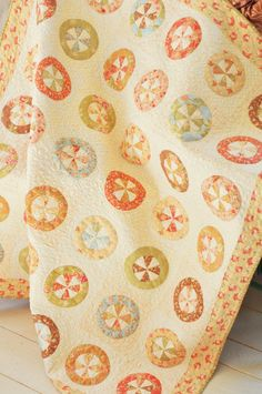 I have this fabric but certainly couldn't make it look this beautiful.  Someday I'll learn to do circles.