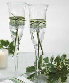 The Celtic Charm Toasting Flutes are wrapped with white lace, green and olive ribbon. The Celtic Trinity Knot, a universal Irish symbol, completes the look.