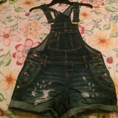 Overall Shorts Denim overall shorts with a distressed, damaged design. Never worn before, but the tags aren't attached. Willing to compromise pricing! lei Jeans
