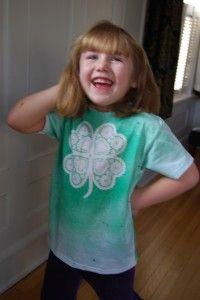 Shamrock T-Shirt- Use 4 paper heart doilies, repositional spray, green fabric spray dye, gold glitter fabric spray paint