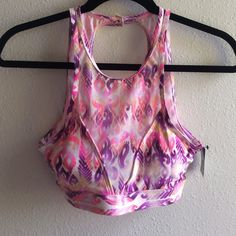 3.99 shipping NWT VS bikini top Halter style with snap closure at top and metal clasp on back. Mesh front, padding included. Size small. Victoria's Secret Swim Bikinis