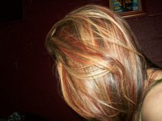 blonde highlights over brown hair with red and black chunks, black underneath. Need to do again