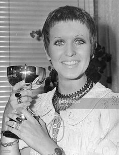 Singer Julie Driscoll, 'Jools', with the cup she received after being voted Britain's top woman vocalist by readers of the Melody Maker.
