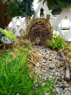 Captivate your children/grandchildren by creating a fairy size door in the corner of your garden.  garden ideas. gardening. gardening with children. fairy tale.