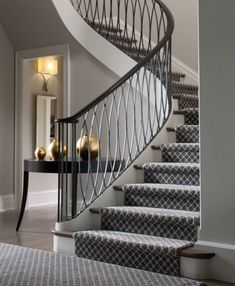Basement stairs ... wrapped carpet stairs. Love the banisters. Dark wood floors. Flat industrial carpeting ... black diamond pattern.