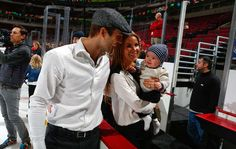 Niklas Hjalmarsson and his wife Elina hold son Theo at this year's Holiday Party.