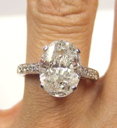 I would die!!!!  1960s 2.86ct Estate Oval Diamond Engagement ring Ring in Platinum. $11,850.00, via Etsy.
