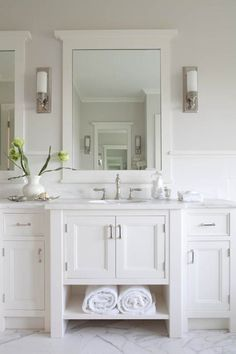 Milton Development: Amazing master bathroom with gray paint color and marble tile bathroom floor. White vanity with white marble counter top. The mirror size is also a nice size. Marble Tile Bathroom, Bathroom Floor Tiles, Laundry In Bathroom, Bathroom Renos, Bathroom Ideas, Tile Floor, Bathroom Mirrors, Bathroom Storage, All White Bathroom