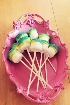 Monster Party Melt white chocolate, use natural dyes, striped paper straws for sticks, and a candy eyeball
