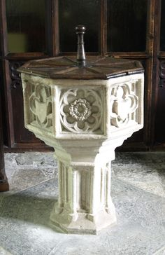 Baltonsborough St Dunstan: the 16th-century font with its 17th-century wooden cover.