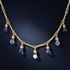 We've seen our fair share of antique jewelry over the decades and this is the first necklace of this type we've ever run across. Alternating amethyst and moonstone briolettes, with a particularly unusual and distinctive shape, are fancifully capped in richly colored 14 karat gold (which look and feel all of 18K). The seven gemstones suspend from a gorgeous matching 17 inch necklace comprised of fancy, elegantly sculpted links. A unique and ravishing Victorian treasure, circa 1865.