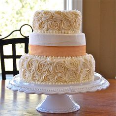 What a fabulous cakes designed by Sister's Baking Co. Elegant but simple. Really brings the colors and essence of a vintage or shabby-chic wedding together.