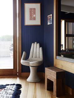 Blue walls and hand chairs