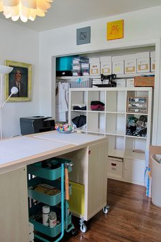 Remember when I moved last year and promised I'd share photos of my new sewing room? Sewing Spaces, My Sewing Room, Sewing Rooms, Quilting Room, Cutting Tables, My Happy Place, Ikea, Desk, Quilts