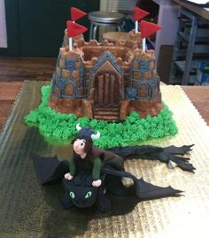 """""""How to train your dragon"""" cake: team effort - I created only the fondant dragon and boy."""