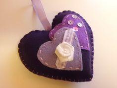 Handmade felt heart in deep purple with flower by Madeinthehoose
