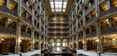 The George Peabody Library, formerly known as the Library of the Peabody Institute, is the 19th-century focused research library of The Johns Hopkins University. It is located on the Peabody campus at West Mount Vernon Place in the Mount Vernon-Belvedere historic cultural neighborhood north of downtown Baltimore, Maryland, across from the landmark Washington Monument.