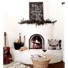@aedriel's supercozy nook, complete with a stoked fire, a handmade garland, a stack of magazines and a glass of vino, looks like our perfect night in!