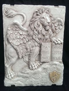 Lion of San Marco, Venice in high relief, Lessinia stone with Royal yellow marble Inlay, probably from early 20th century. The work has been fully worked and carved by hand. It comes from the city of Gorizia, Friuli Venezia Giulia and was placed in the ma