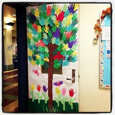 Front door of classroom decorations - 100 Hands for 100 Days of School. Trace and cut out the children's hands in various colors. Use the hands as leaves on the tree (tree is also a hand - fingers for branches), as flowers and as wings of butterflies.