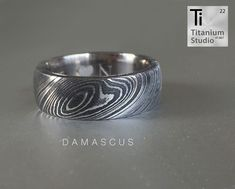 We created a hypoallergenic titanium inner with a Damascus steel outer. Damascus Ring, Damascus Steel, Titanium Rings, Wedding Bands, Rings For Men, Silver Rings, Jewellery, Accessories, Sleeve