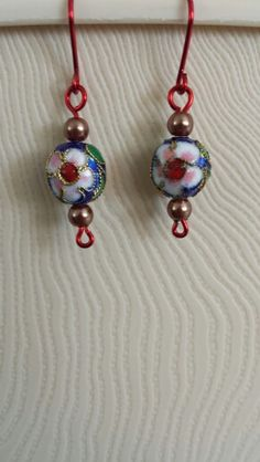 Embossed beads with light brown glass pearls and red wiring.  $15 #B001  JewelryArtByLinda@gmail.com