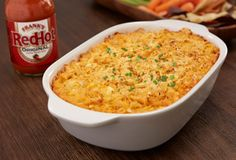 Dip away. Besides the guacamole, add a flavorful, creamy, cheesy Buffalo Chicken Dip to your repertoire. It's another appealing variation on those classic football flavors. Chicken Nachos Recipe, Chicken Dips, Chicken Wing Recipes, Chicken Bombs, Chicken Puffs, Cooked Chicken, Chicken Fajitas, Buffalo Chicken Nachos, Buffalo Chicken Sandwiches