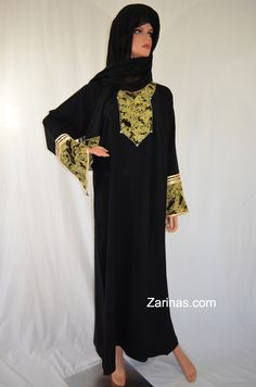 "The Rashida Glittering Abaya is decorated with beautiful silver color gem stones and simple gold color embroidery. The fit of this outfit is loose, comfortable, and falls straight down while the fabric is soft and breathable. Dress modest and stylish, all at the same time with this elegant dress. Comes with a beautiful matching scarf and niqab. Available in these sizes:  52: 20"" across, 51"" long (Small)  58: 24"" across, 57"" long (X Large)  60: 25"" across, 59"" long (XX Large)"