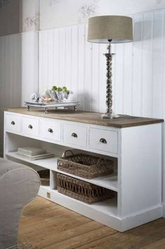 Console table with rattan baskets, love the wood floor