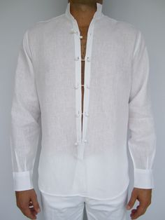 Men's linen shirt with a Mandarin collar and hand-sewn cotton closures.  Available in white only.