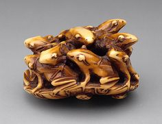 Seimin (Japan)   Frogs on Lotus Leaf, mid- to late 19th century  Netsuke, Ivory with staining, sumi,