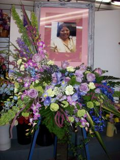 Funeral waterfall in lavenders, greens and blues accenting picture