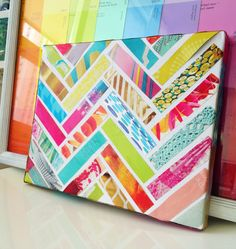 Colourful strips of magazines or paint cards glued to canvas creates unique design