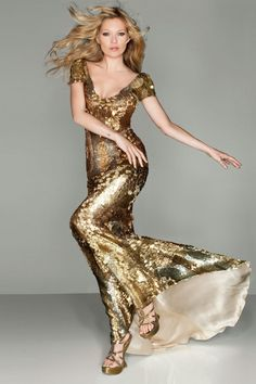 Kate Moss wears a bespoke Alexander McQueen's gold gown in tonight's London 2012 Closing Ceremony.