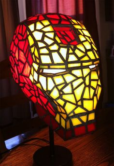 This is the new Iron Man stained glass desk lamp I recently completed. New Stained Glass Version of the Iron Man Helmet Iron Men, Superhero Lamp, Superhero Party, Iron Man Helmet, Avengers Characters, Nerd Crafts, Ideias Diy, Stained Glass Lamps, Oeuvre D'art