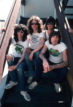 LR Joey Ramone Tommy Ramone Dee Dee Ramone and Johnny Ramone of the rock and roll band 'The Ramones' pose for a portrait holding letters that spell...