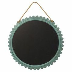 """Jot down to-do's and grocery lists on this charming metal chalkboard, showcasing a scalloped frame and rope-inspired accent.  Product: ChalkboardConstruction Material: Metal, rope and chalkboardColor: Black and blueFeatures: Easy to hangDimensions: 16"""" H x 12"""" W x 1"""" DCleaning and Care: Lightly dust"""