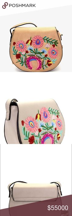 """Coming! Tan Flower Embroidered Flap Crossbody Bag Coming! Tan Flower Embroidered Flap Crossbody Bag. Vegan Leather. Zip Top Closure. Adjustable Strap. 7""""L x 6""""H x 3""""D. Price is Firm Unless Bundled GlamVault Bags Crossbody Bags"""