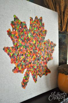 melted crayon/wax leaf canvas art.