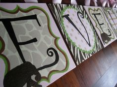 custom painted canvas wall letters - silhouette safari. $13.00, via Etsy.